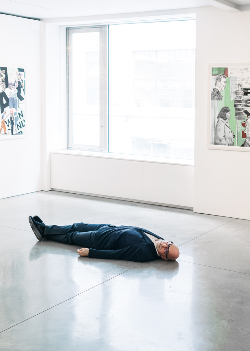Steven Kasher lying down in his Gallery